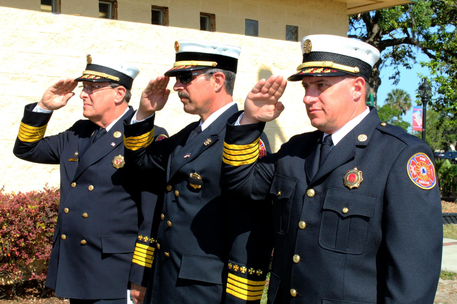 Fire chiefs in full uniform saluting