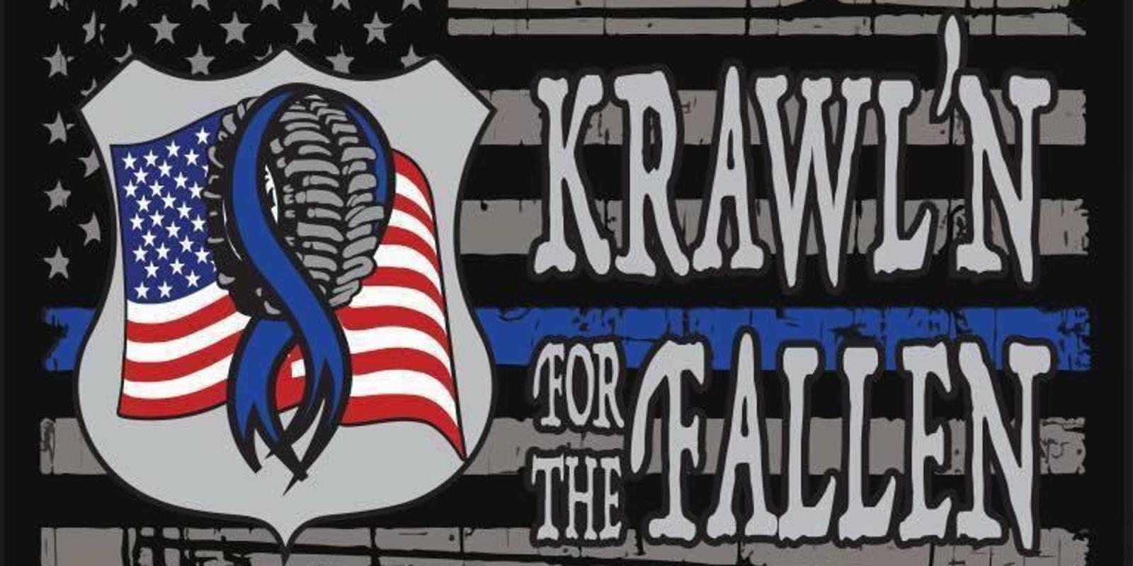"""Krawl'n For the Fallen"" over and American Flag with the blue line with Amercan flag in badge with a tire and blue ribbon"