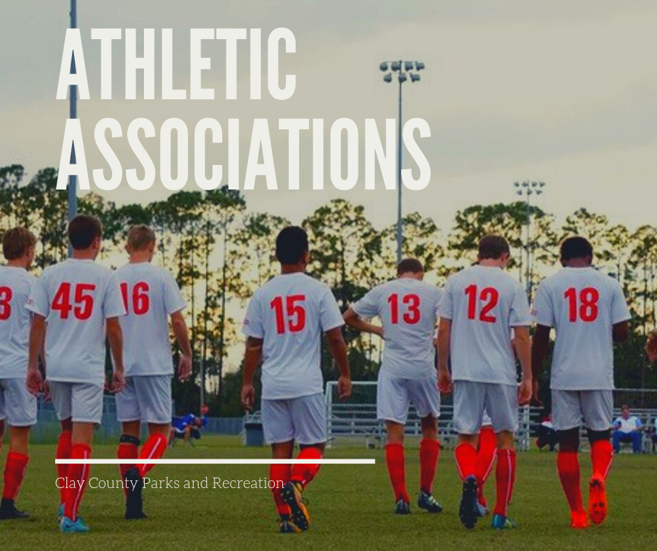 """Athletic Associations"" boys in soccer uniform on field with sun setting"