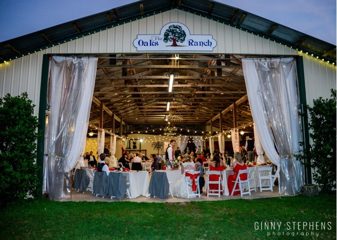 Barn venue with table and chairs set up for wedding
